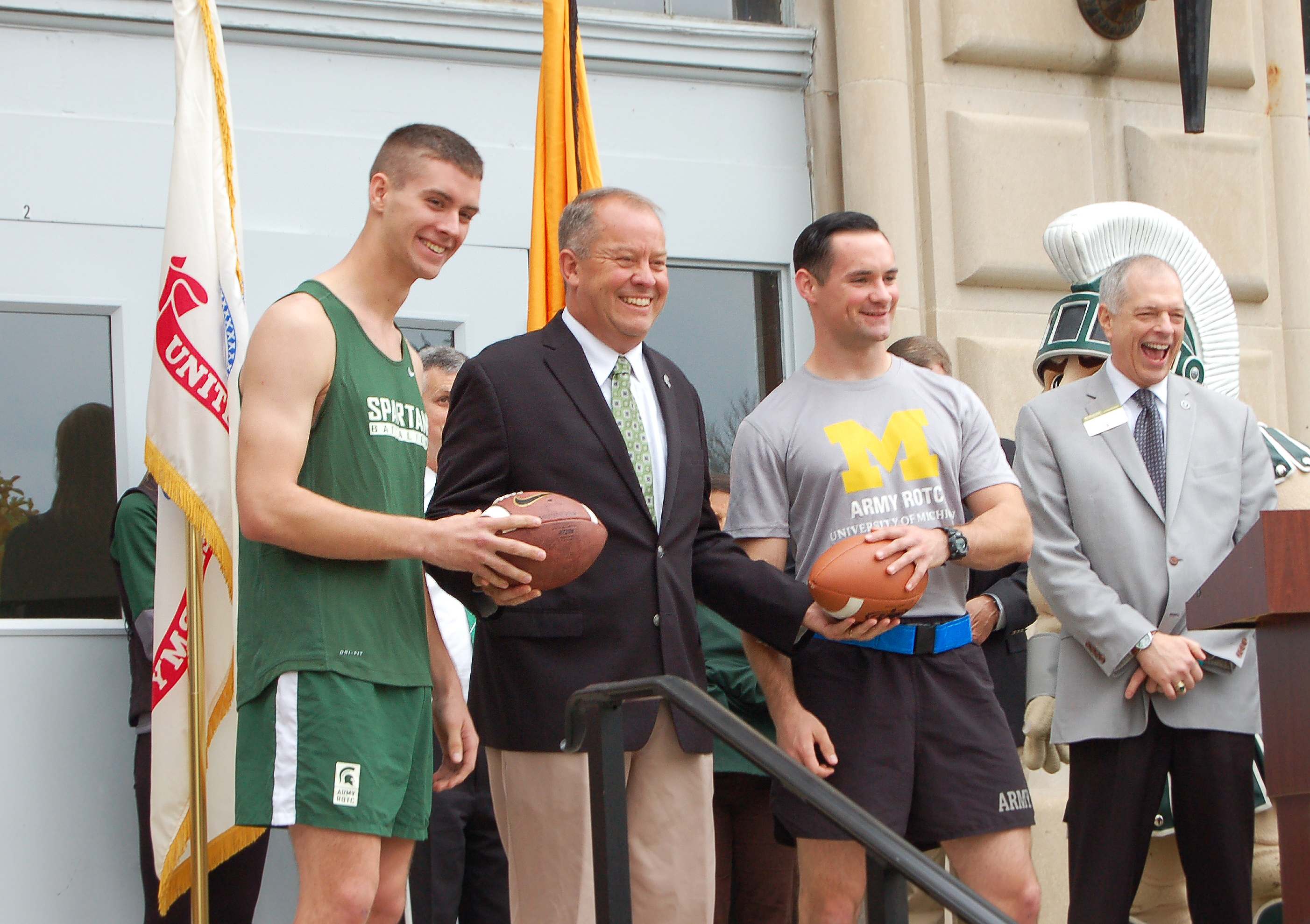 "MSU and UM ROTC Cadets present the game ball to MSU Athletic Director, Mark Hollis at the conclusion of the inaugural ""Alex's Great State Race"" in October of 2014."